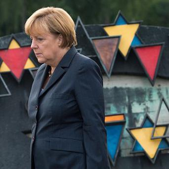 German chancellor Angela Merkel walks to a wreath-laying ceremony during her visit to the former Nazi concentration camp in Dachau(AP Photo)