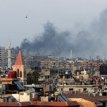 Smoke rises from heavy shelling in west Damascus (AP)