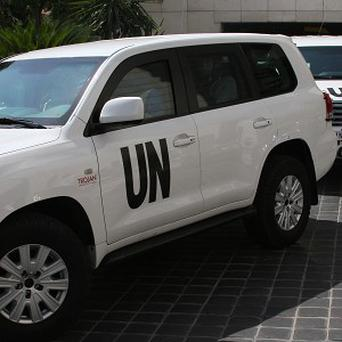 The UN team setting off from their hotel before they were attacked (AP)