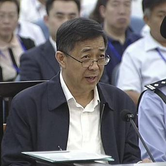 Former Chinese politician Bo Xilai speaks in a court room at Jinan Intermediate People's Court in Jinan (AP)