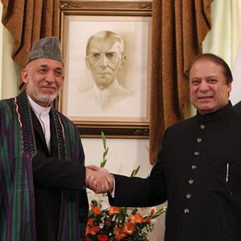 Afghan President Hamid Karzai meets with Pakistani Prime Minister Nawaz Sharif to discuss the Taliban (AP)