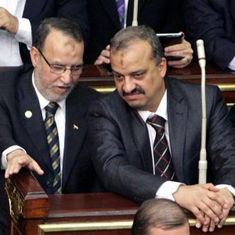 Muslim Brotherhood member Mohamed El-Beltagy, right, has been arrested by Egyptian police, On his left is Essam el-Erian, vice chairman of the Freedom And Justice party (AP)