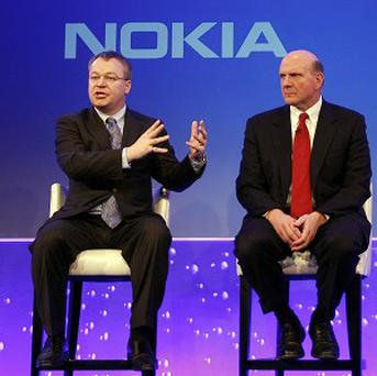 Stephen Elop, CEO of Nokia, left, with CEO of Microsoft Steve Ballmer (AP)