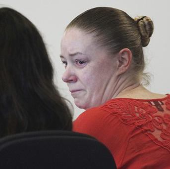 Aisling Brady McCarthy sits with her lawyer during a hearing to request charges be dropped (AP/The Boston Globe,Wendy Maeda)