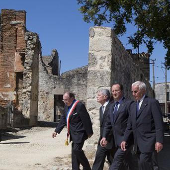 The German and French presidents in the massacre town (AP)