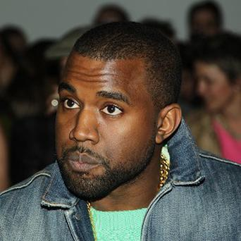 Kanye West's turn at a Kazakhstan wedding has been criticised by a human rights group