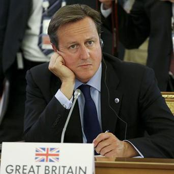 Prime Minister David Cameron listens to statements during a round table meeting at the G20 summit (AP)