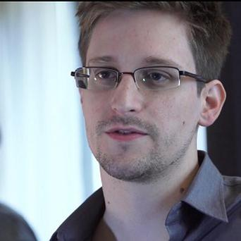 Edward Snowden worked as a contract employee at the National Security Agency (AP/The Guardian, Glenn Greenwald and Laura Poitras)
