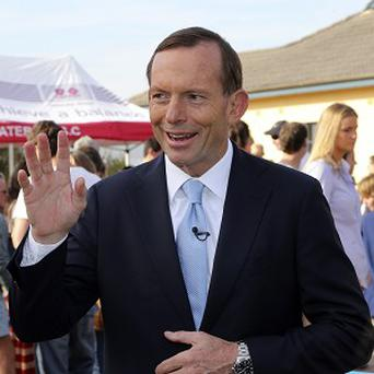 A win for the coalition comes despite the relative unpopularity of party leader Tony Abbott (AP)