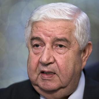 Syrian Foreign Minister Walid al-Moallem says his country has agreed to surrender its chemical weapons (AP)