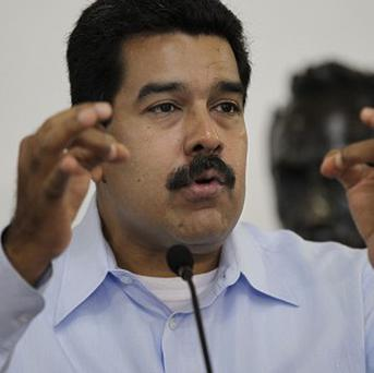 Venezuela's president Nicolas Maduro accused the political opposition for an explosion at the country's main oil refinery (AP/Ariana Cubillos)