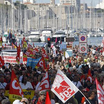 French workers demonstrate iin Marseille over government pension reforms (AP)