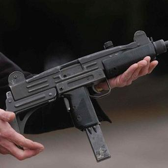 A Jordainian MP has been charged with trying to murder a colleague with an automatic rifle in parliament (AP)