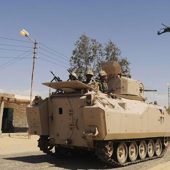 Egyptian soldiers in a sweep through villages in Sinai, Egypt (AP)