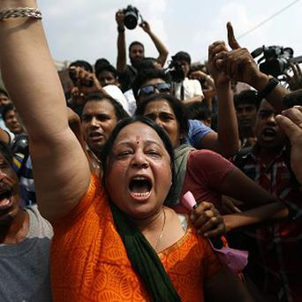 Protesters outside the court demanding the death penalty for the rapists (AP)