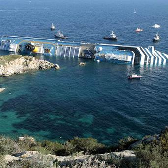 Work to turn the Costa Concordia upright is due to begin next week (AP)