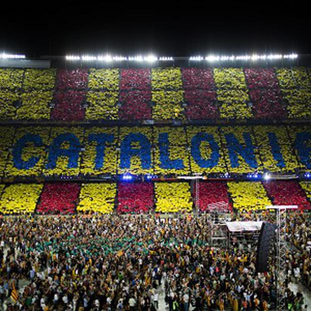 Supporters make a mosaic with the words of Catalonia at a pro-independence festival in the Nou Camp stadium in Barcelona (AP)