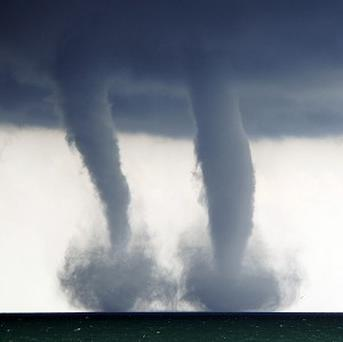 A pair of water spouts on Lake Michigan in the US (AP/The Kenosha News)