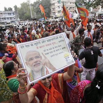 Supporters of India's main opposition Bharatiya Janata Party (BJP) celebrate after Narendra Modi was announced as the party's prime minster candidate for the 2014 polls (AP)