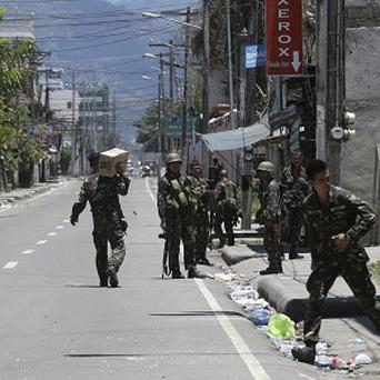 Fighting continues between the military and Muslim rebels at Zamboanga city in southern Philippines (AP)