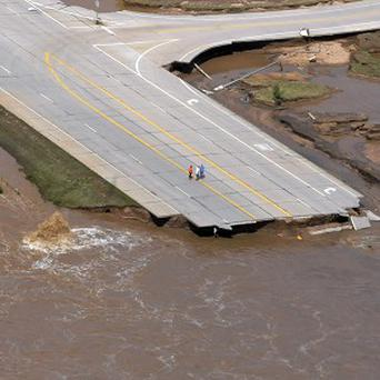 Road damage after floods in Colorado (AP/The Greeley Tribune, Joshua Polson)