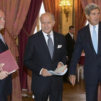 British Foreign Secretary William Hague,French Foreign Minister Laurent Fabius and US Secretary of State John Kerry (AP)