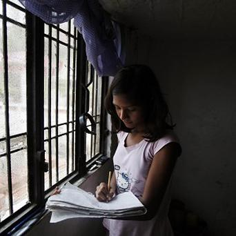 Sushma Verma who is studying for a master's degree at the age of 13 (AP)