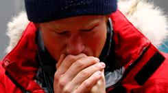 Britain's Prince Harry warms his hands after a cold chamber training exercise with the Walking with the Wounded South Pole Allied Challenge 2013 British team. REUTERS/Darren Staples