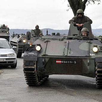 Austrian soldiers in armoured vehicles have been called in to the siege (AP)