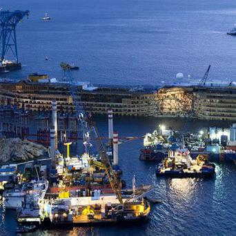 The Costa Concordia is seen after it was lifted upright on the Tuscan island of Giglio (AP)
