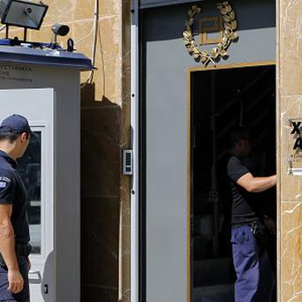 Police at the HQ of Greece's far-right Golden Dawn party (AP)