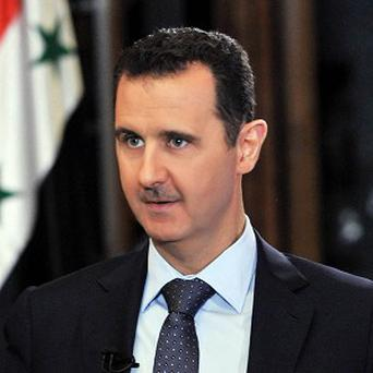Syrian president Bashar Assad denies his regime orchestrated the chemical weapon attack that killed hundreds of people (AP)