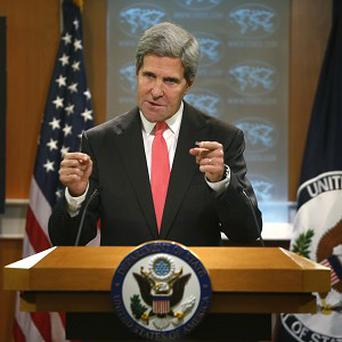 Secretary of State John Kerry makes a statement about Syria (AP)