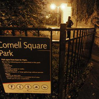 Police at the scene of the shooting at Cornell Square Park, Chicago (AP)