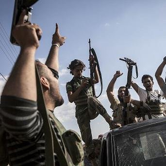 Opposition fighters return from the battlefield in Syria's Idlib province (AP)
