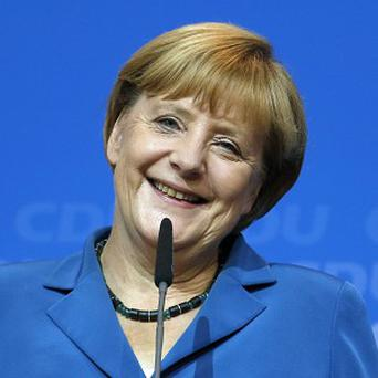 Chancellor Angela Merkel talks to supporters at the party headquarters in Berlin (AP)