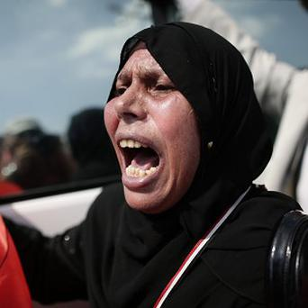 Pro-Mubarak supporters demonstrate against ousted president Mohammed Morsi and the Muslim Brotherhood (AP)