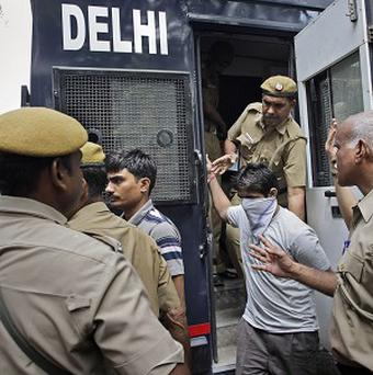 Two of the four men sentenced to death for raping a young woman on a bus are brought to the High Court in New Delhi, India (AP)