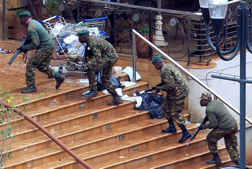 Kenya Defence Forces soldiers take their position at the Westgate shopping centre, on the fourth day since militants stormed into the mall, in Nairobi September 24, 2013