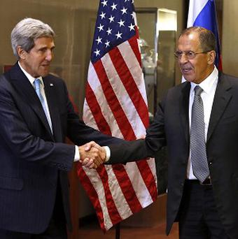 US Secretary of State John Kerry greets Russian Foreign Minister Sergey Lavrov at the United Nations General Assembly (AP/Jason DeCrow)