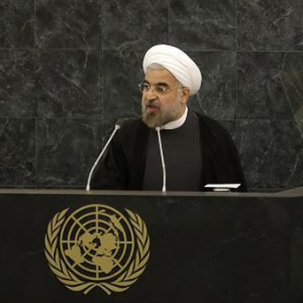 Iranian president Hasan Rouhani speaks at a meeting on nuclear disarmament (AP)