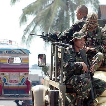 Some 4,500 government troops and police ended a deadly three-week battle between government troops and Muslim rebels who held nearly 200 people hostage in the southern Philippines (AP/Al Jacinto)