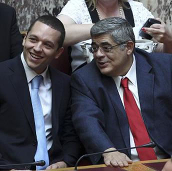 Golden Dawn party leader Nikos Mihaloliakos, right, has been arrested (AP)