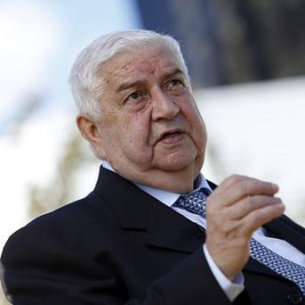 Syrian Foreign Minister Walid al-Moallem said Syria's government will not accept any transition peace plan that excludes President Bashar Assad (AP)