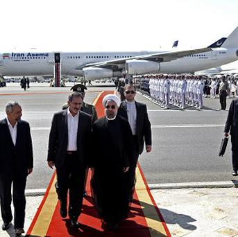Iranian President Hassan Rouhani (centre) was criticised by some for having a phone conversation with Barack Obama (AP)