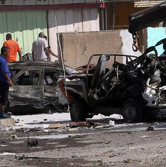 One of the car bomb sites in Baghdad (AP)