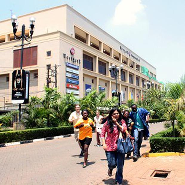 Shoppers flee from the Westgate Mall on the opening day of the attack (AP)