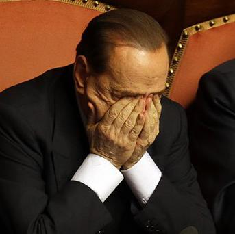 A Senate committee has recommended that Silvio Berlusconi lose his Senate seat due to his tax fraud conviction (AP)
