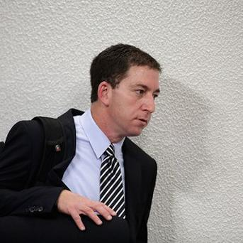 American journalist Glenn Greenwald arrives to speaks before a congressional committee investigating reports based on documents leaked by former National Security Agency contractor Edward Snowden (AP)