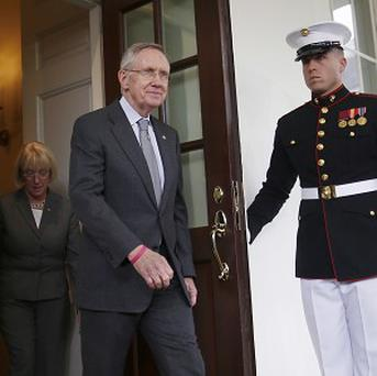 Senate Majority Leader Harry Reid walks out of the West Wing of the White House (AP/Charles Dharapak)